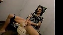 Horny wife masturbates with toilet brush