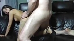 Brunette MILF in nilon stockings gets doggystyle fuck on sofa